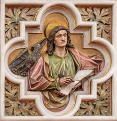 VIENNA, AUSTIRA - JUNI 24, 2021: The relief of St. John the Evangelist in church St. Severin by unknown artist