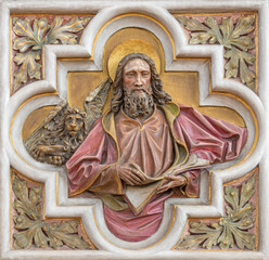 VIENNA, AUSTIRA - JUNI 24, 2021: The relief of St. Mark the Evangelist in church St. Severin.