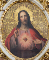 VIENNA, AUSTIRA - JUNI 24, 2021: The painting of heart of Jesus Christ from church St. Gertrude Pfarrkirche by unknown artist of 19. cent..