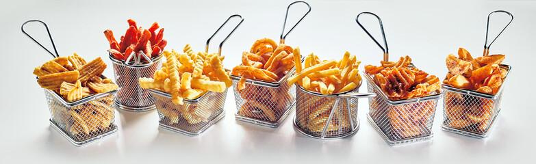 Fototapeta Metal baskets with French fries on white background obraz