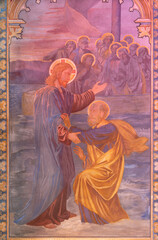 VIENNA, AUSTIRA - JUNI 24, 2021: The fresco of Narrow gate to kingdom of God in the Votivkirche church by brothers Carl and Franz Jobst (sc. half of 19. cent.).