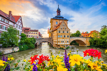 Obraz Bamberg, Germany. Town Hall of Bamberg (Altes Rathaus) with two bridges over the Regnitz river. Upper Franconia, Bavaria. - fototapety do salonu