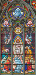 VIENNA, AUSTIRA - JUNI 24, 2021: The Baptism of Jesus on the stained glass in the Votivkirche church originaly by workrooms from Austria.