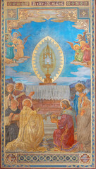 VIENNA, AUSTIRA - JUNI 24, 2021: The fresco of Adoration of holys in front of Eucharist in the Votivkirche church by brothers Carl and Franz Jobst (sc. half of 19. cent.).