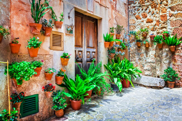 Charming old streets decorated by flowers. Mediterranean culture and traditional villages