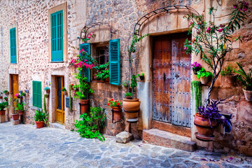 Beautiful floral streets with old doors and windows. Mediterranean culture and traditional villages