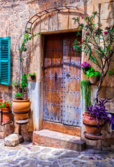 Charming floral streets with old doors and windows. Mediterranean culture and traditional villages