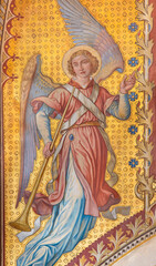 VIENNA, AUSTIRA - JUNI 24, 2021: The fresco of angel with the tompeth in the Votivkirche church by brothers Carl and Franz Jobst (sc. half of 19. cent.).