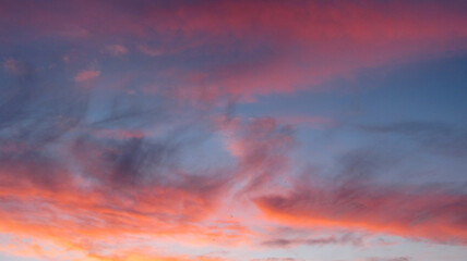 Crimson sunrise with pink clouds
