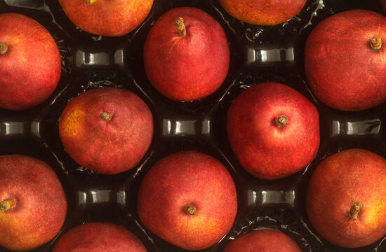 Top view of a crate with Red Anjou Pears