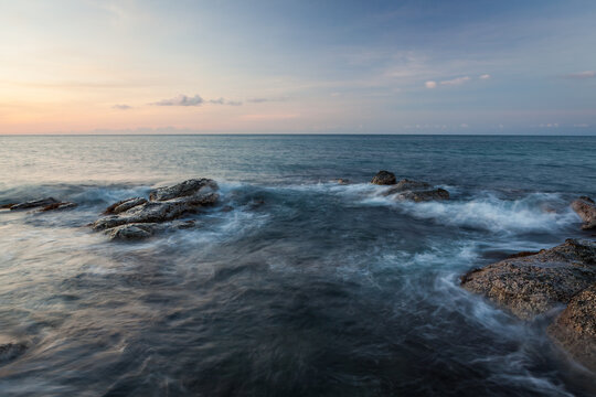 Waves and rocks shore long exposure