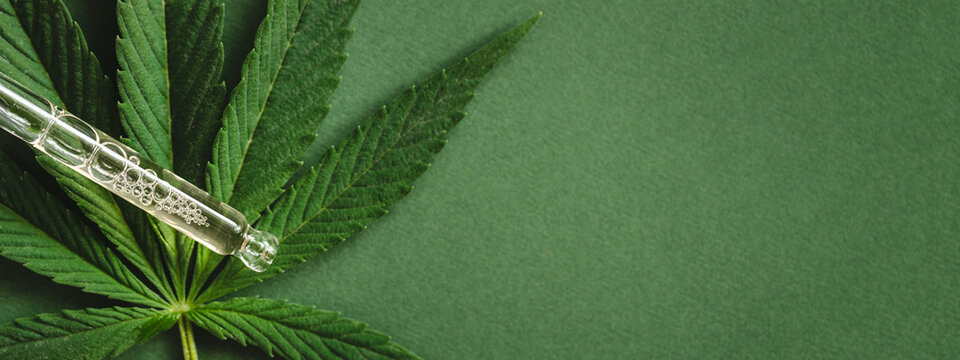 Green banner with pipette with cannabis extract.