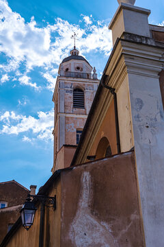 Underneath view of the typical corsican church under blue sky in the Ajaccio city.