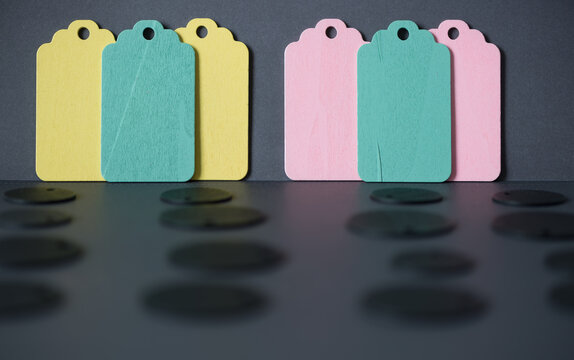 old-school mid-century modern tags in pastel green, yellow, and pink on dark gray background