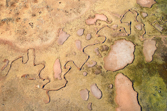 Aerial view of the strange, inhospitable landscape of the Sanetti plateau. Zigzagging shapes, erosion, Martian landscape. Bale mountains national park landscape, travel around Ethiopia.