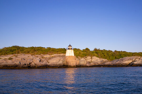Beautiful Castle Hill Lighthouse seen of the coast of Newport Rhode Island on a sunny day