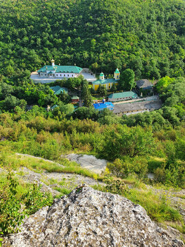 High angle view from altitude to the Saharna Monastery, Moldova. Idyllic place with the church in the middle of woods on the gorge valley