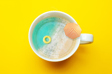 Beach in the coffee cup with inflatable doughnut