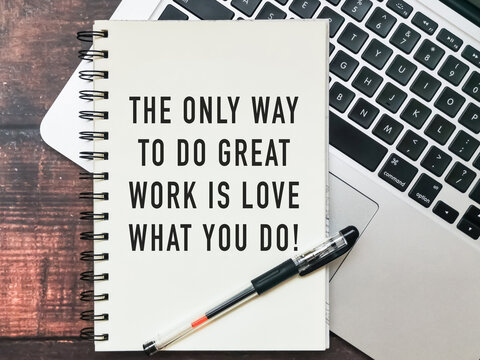 """Open notebook with text """"the only way to do great work is to love what you do"""" and a laptop on wooden background."""