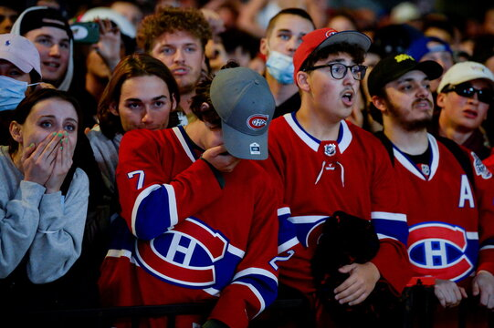Fans react as they watch the end of game five of the NHL Stanley Cup Finals
