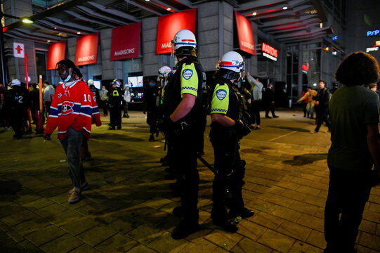 Montreal police quickly react to disperse the crowd at the end of game five of the NHL Stanley Cup Finals