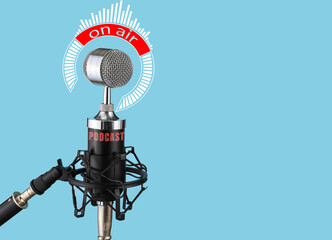 Modern microphone on color background