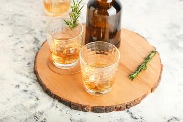 Fototapeta Bottle and glasses of cold whiskey on light background obraz