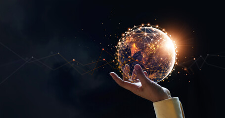 Fototapeta .Businessman holding night earth and global networking connection and data exchanges, global communication network concept, Elements of this image furnished by NASA. obraz