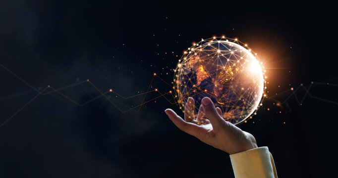 .Businessman holding night earth and global networking connection and data exchanges, global communication network concept, Elements of this image furnished by NASA.