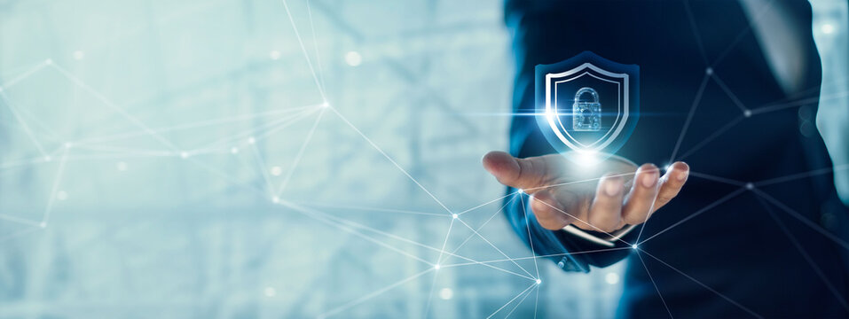 .Businessman holding Shield with padlock in hand on global networking connection, Data protection and network security, insurance business, internet fire wall and crime cyber protection.