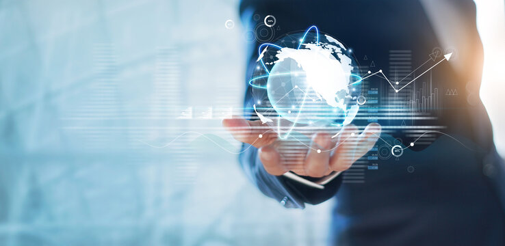 Businessman holding circle global network connection and data exchanges worldwide on work place background, business network communication and technology concept