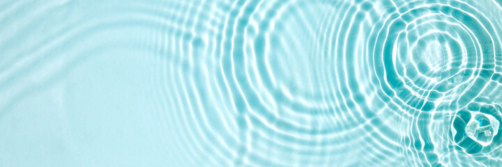 Fototapeta Blue water texture, blue mint water surface with rings and ripples. Spa concept background. Flat lay, copy space. obraz