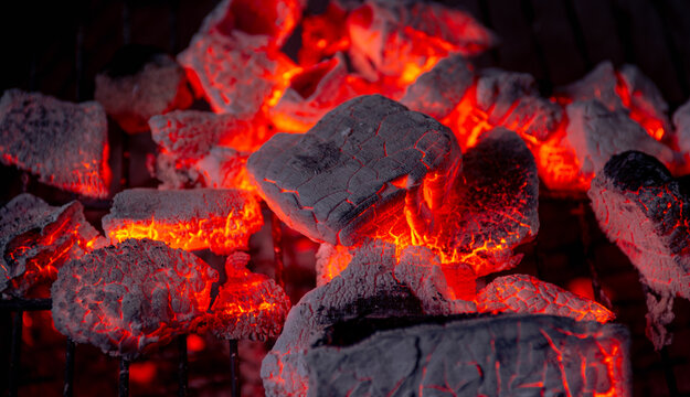 Burning coals from a fire abstract background