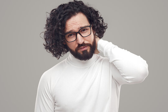 Confident bearded man in eyeglasses looking at camera