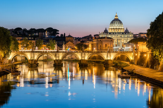 Rome skyline at night with view of St. Peter's Basilica and Tiber River