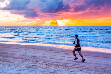 person running on the beach