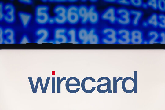 June 14, 2021, 2021, Brazil. In this photo illustration a Wirecard AG logo seen displayed on a smartphone with the stock market information in the background.