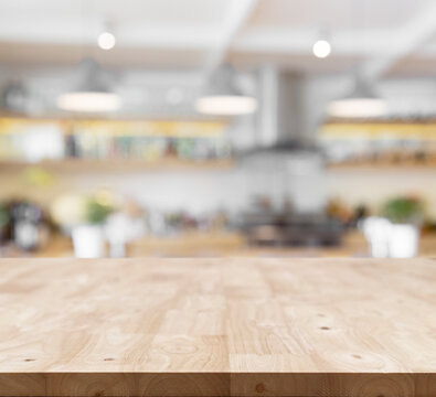 new wood top table layer on blur kitchen background