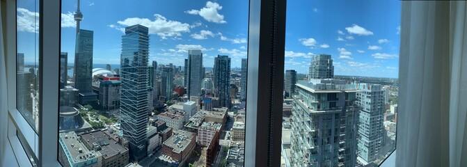 Fototapeta Cityscape Against Sky Seen Through Glass Window obraz