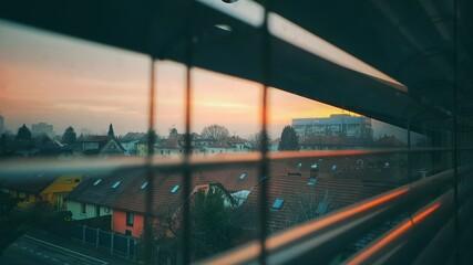 Fototapeta City Seen Through Glass Window During Sunset obraz
