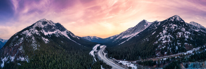 Obraz Aerial Panoramic View of a scenic Highway passing in the Canadian Mountain Landscape. Dramatic Sunset Sky Art Render. Taken near Hope and Merritt, British Columbia, Canada. - fototapety do salonu