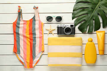 Fototapeta Flat lay composition with beach objects on white wooden background obraz