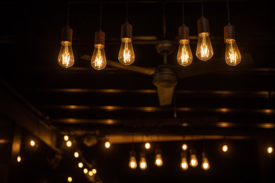 spotlights, incandescent bulbs hanging in the dark room. Led lights. Inefficient filament lamps waste electricity. Decorative vintage bulbs with straight wire,dark, darkness, night, lights, lighting