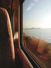 Fototapeta Scenic View Of Sea Seen Through Train Window obraz