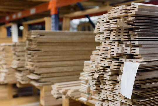 Warehouse with stacked wooden timber on racks for construction and repair