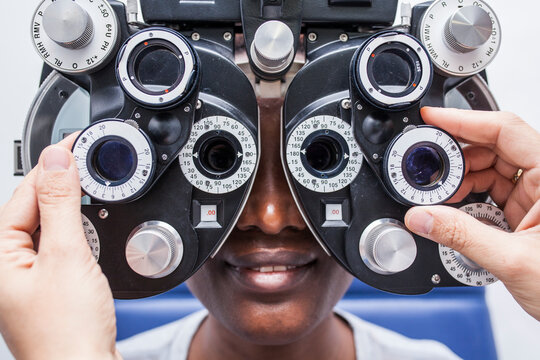 Black woman in optometry cabinet