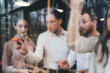 Fototapeta Focused colleagues working on project obraz