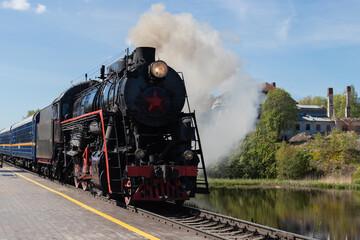 a black retro steam locomotive close up