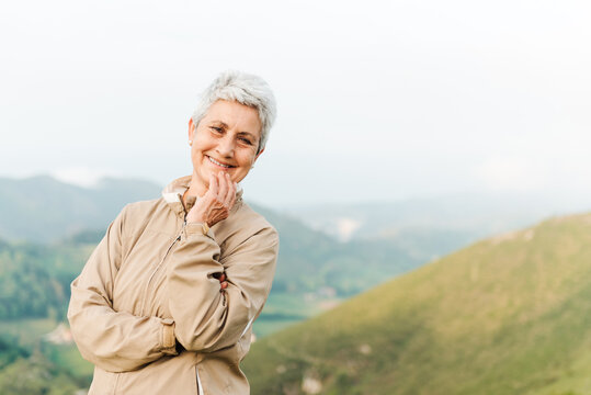Delighted aged woman in countryside