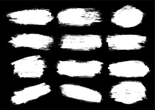 set de manchas de pinceles diferentes en blanco y negro, pinceladas blancas en fondo negro